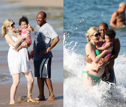 Byron Allen, his wife Jennifer Lucas, and daughter Chloe play in the ocean in Hawaii